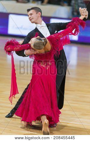 Minsk Belarus-October 7 2017: Dance Couple of Karatkevich Vladimir and Kravchenko Nataliya Performs Adults European Standard Program on WDSF International Capital Cup Minsk- 2017 in October 7 2017 in Minsk Belarus.