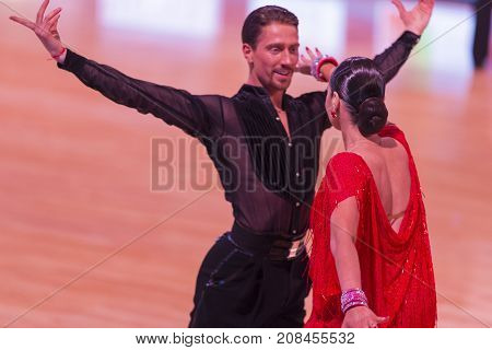 MinskBelarus-October 72017:Pro-Am Dance Couple of Aleksander Rodygin and Yulia Binus Performs Pro-Am International Scholarship Latin-American Program on WDSF International Capital Cup MinskOctober 72017 MinskBelarus