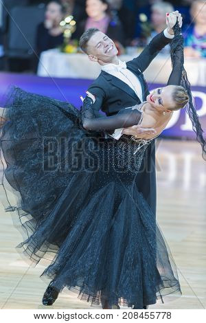 Minsk Belarus-October 7 2017: Dance Couple of Buldyk Sergey and Raiko Alena Performs Adults European Standard Program on WDSF International Capital Cup Minsk- 2017 in October 7 2017 in Minsk Belarus.
