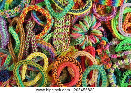 Background - various kinds of colorful bracelets, braided from rubber