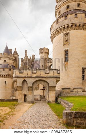 September 2012- In September a lot of tourist visit the Medieval Castel of Pierrefond in the north of Paris in France restored by Viollet-le-Duc to enjoy its architecture. Main Entrance view.