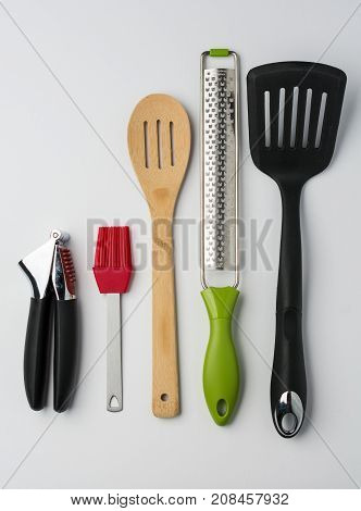 Garlic Press Brush Spoon Spatula Zester on White Background