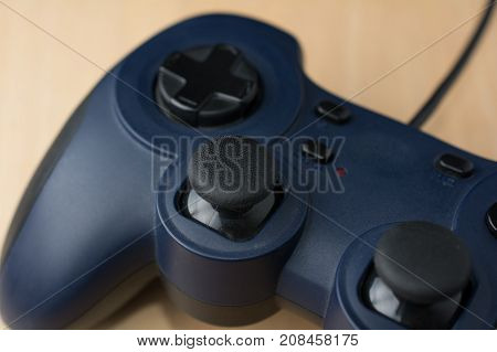 Video Game Controller on Wood Background Close Up Perspective View