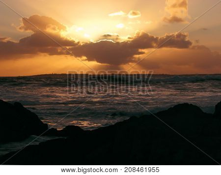 VIEW OF A SILHOUETTE IN THE FORE GROUND, AND A  GOLDEN RED SUN SETTING OVER THE HORIZON  06d