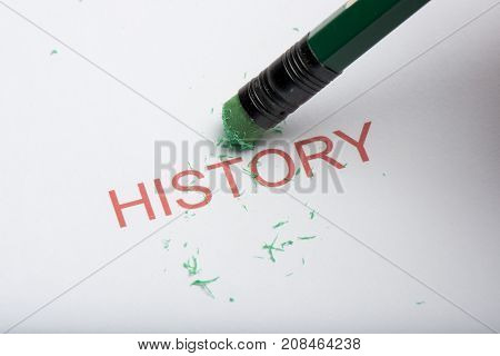 Pencil Erasing The Word 'history' On Paper