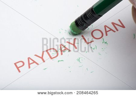 Pencil Erasing The Word 'payday Loan' On Paper