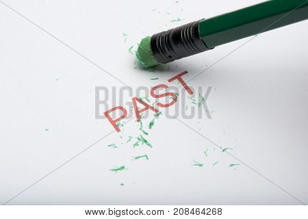 Pencil Erasing The Word 'past' On Paper