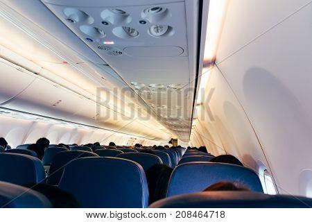 Inside the plane Airplane Passenger cabin .