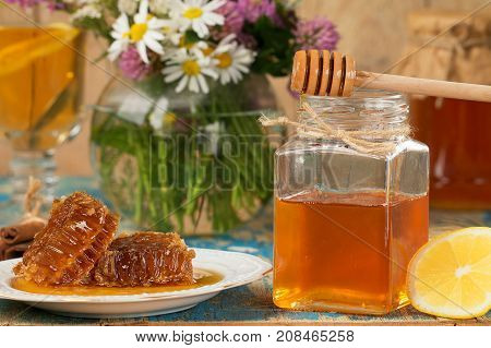 Honey in a pot or jar on kitchen table. Healthy organic food