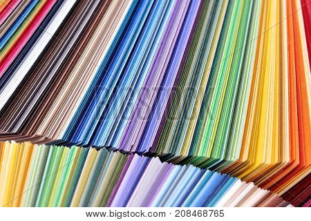 stacked colorful paper - variation of different colored paper - color samples