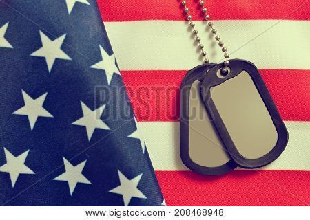 Close up of american flag and soldiers badges.Veterans Day Concept.