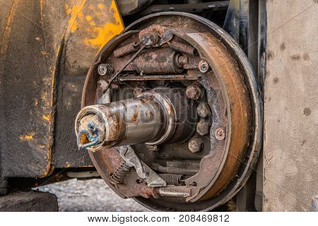 Closeup View Of Exposed Rusty Break Shoe Assembly