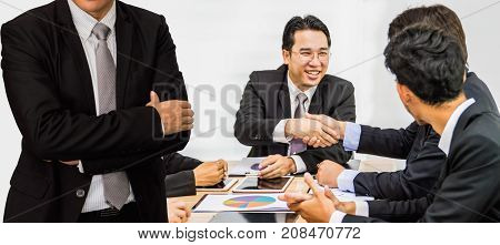 Half of the businessmen meeting for the planning meeting.