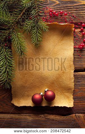 Christmas Background - Baubles And Branch Of Spruce Tree With Blank Paper Sheet