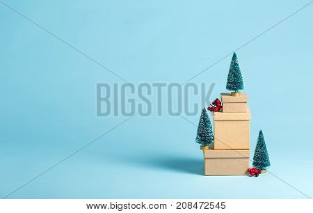 Collection of Christmas present boxes and Christmas trees on a blue background