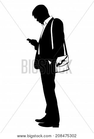 Silhouette of a man in a business suit dialing a number on the phone