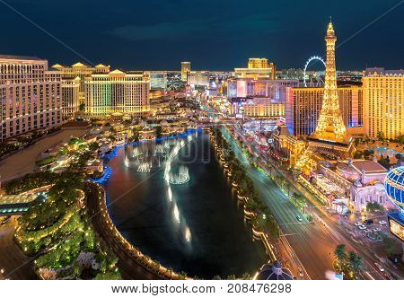 Aerial view of Las Vegas strip at night on July 25, 2017 in Las Vegas, Nevada. Caesars Palace, the Flamingo and Paris Hotel and casino are in the background.