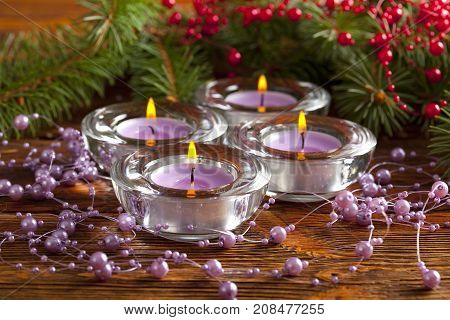 Four Christmas Candles And Branch Of Xmas Tree