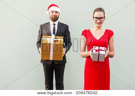 Focus On Woman. Couple Showing Colorful Box And Smiling