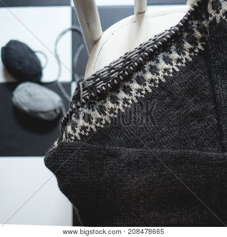 Unfinished Knitted Sweater On Knitting Needles