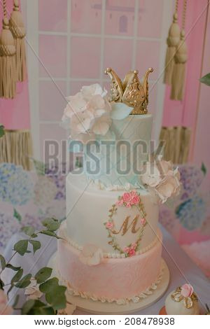 a cake decorated with hydrangea and crown