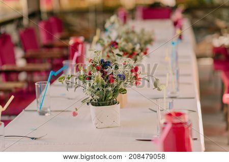 a bouquet of wildflowers on a festive table