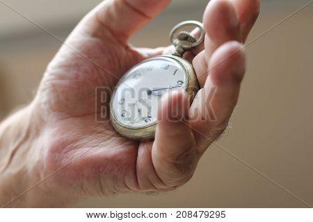 antique watch in a senior men's hand