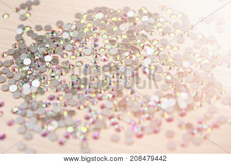 Shiny rhinestones background Close up of a whie all covered with shiny rhinestones