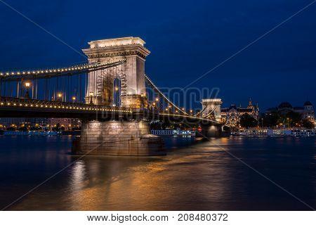 Beautiful night shot of the illuminated Chain Bridge in Budapest across the Danube river in Hungary.