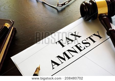 Papers about tax amnesty and gavel in a court.