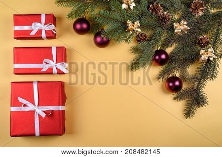 Christmas Background With Red Gift Boxes, Fir Tree Branches With Glass Balls, Pine Cones, Cinnamon S