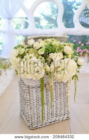 Beautiful bouquet of white flowers in wicker basket free space. Wedding flowers arrangement in basket copy. Romance love valentine's day holiday concept