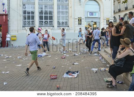 LE MANS FRANCE - JUNE 16 2017: Garbage from cans and plastic and paper on the street after the parade of pilots racing in Le mans France