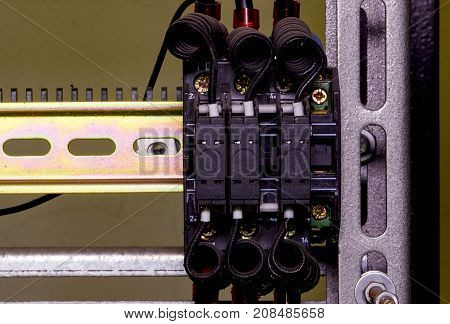 Modern Terminal Blocks With Black Colored Wires.  Closeup