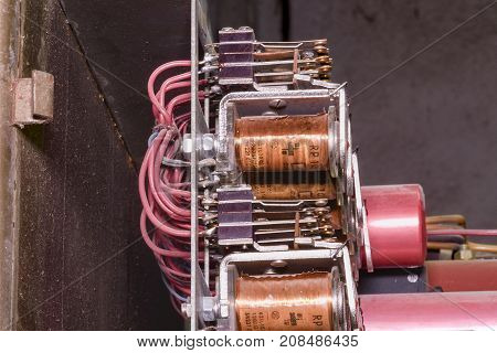 Old Electric Devices In Electric Distribution Case. Closeup