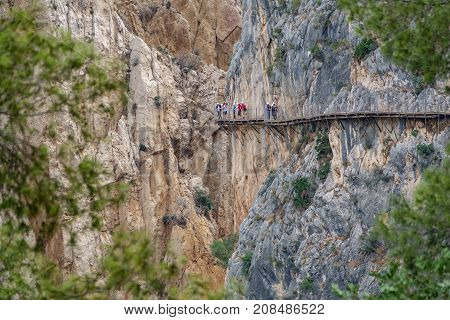 Long shot of King's Little Path footpath across vertical wall with tourists, one of the most Dangerous in the world n2
