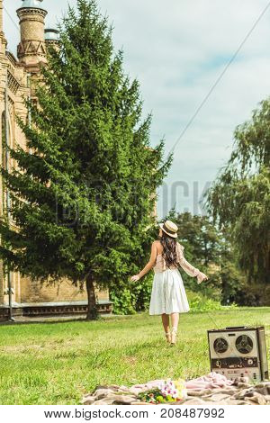 Stylish Girl In Straw Hat At Park