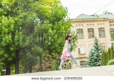 Happy Girl With Roller Skates