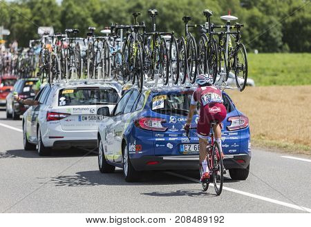 Mailleroncourt-Saint-Pancras France - July 5 2017: Rear image of the Portuguese cyclist Tiago Machado of Team Katusha-Alpecin riding behind a technical car on a road to La Planche des Belle Filles during the stage 5 of Tour de France 2017.