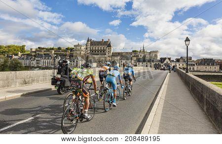 AmboiseFrance - October 82017: The breakaway passing on the bridge in front of Amboise Castle during the Paris-Tours road cycling race.