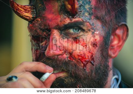 Halloween Satan With Red Blood And Wounds On Face Skin