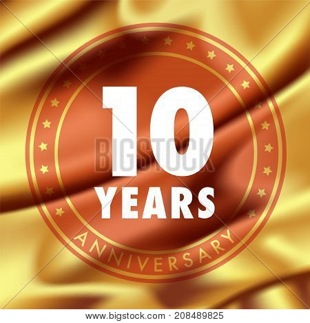 10 years anniversary vector icon logo. Template design element with golden medal in silk for 10th anniversary greeting card can be used as decoration element