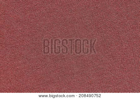 red background of texture of knitted material or plexus fabric closeup