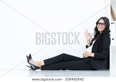 Pregnant Businesswoman Showing Okay Sign