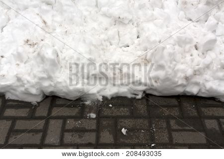 Dirty Snow Pile On The Pavement
