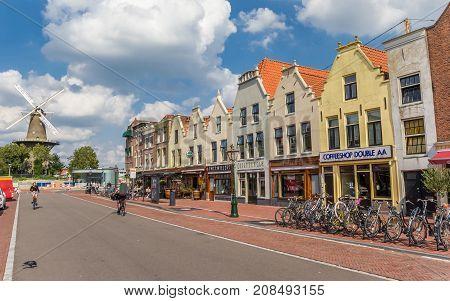LEIDEN, NETHERLANDS - SEPTEMBER 03, 2017: Shopping street and old windmill in Leiden Holland