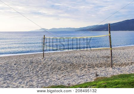 Beach volley court with sea background close