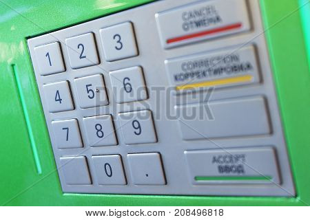 Keyboard with buttons for managing and entering ATM machine digits. Close-up, soft focus and beautiful bokeh.