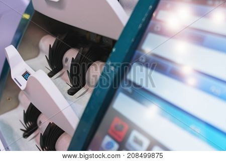 Device for recounting banknotes for cash reception in a bank and a financial institution, the cashier's shop with electronic display for information output, close-up, soft focus.