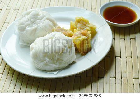 Chinese steamed bun stuffed minced pork and Dim sum with soy sauce